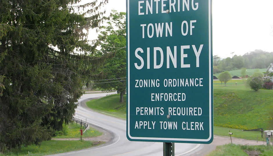 photo of Highway Department sign labelled Entering the Town of Sidney